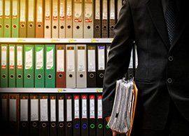 Colombian Lawyer Holding Data Files for Regulatory Services
