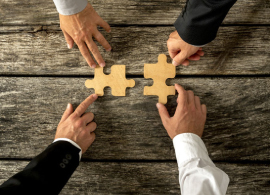 Business People Joining Forces in Merger and Acquisitions